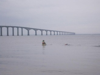 Big Swim 2014 – Kayak support for a swimmer Emma Shaw – Leaving the shores of New Brunswick along the Confederation Bridge to Prince Edward Island