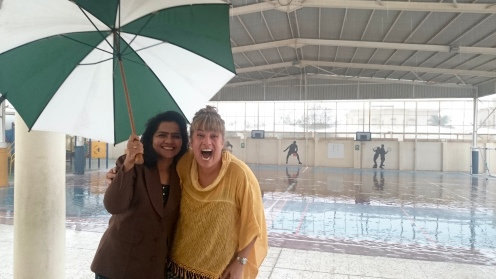 Staff getting pictures during the rain storm because it's SO RARE…..now who IS that geek in the yellow…..