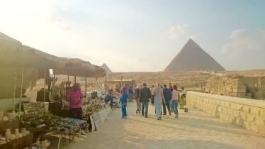 Tents of sellers line the busy side of the Sphinx