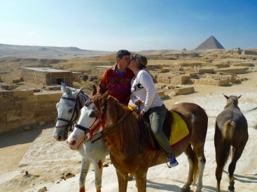 Stopping for a kiss and to see the mastabas (tombs) and rock cut tombs along the causeway