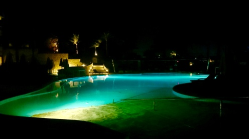 The pool lit up at night