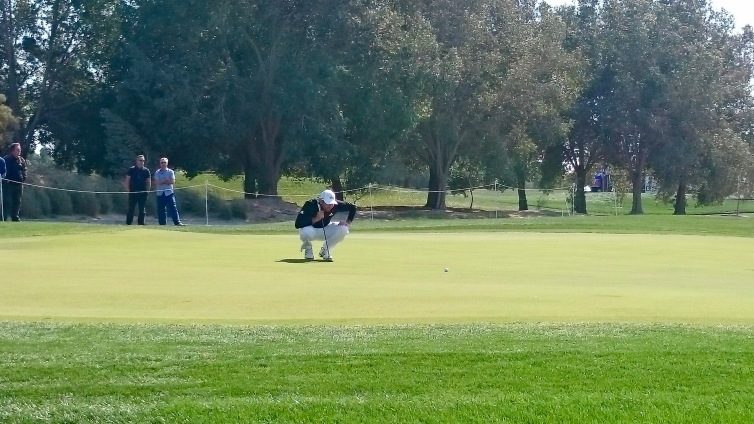 Sergio getting ready to putt