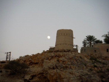 Full moon over an ancient tower.