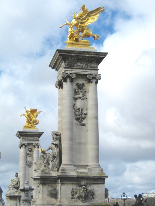 Left Bank Fames, the entrance to the Pont Alexandre III Bridge