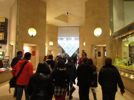Entering the main entrance of the Louvre before entering the Louvre.....