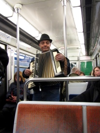 Accordion player entertaining everyone on the Metro train...with a purse for offerings after his show!!