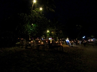 At night, the bars along the beach transform into restaurants with candlelit tables.