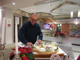 The owner serving cheese