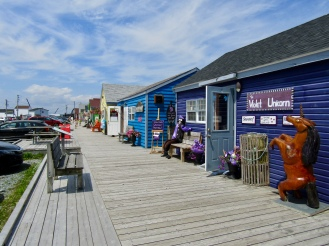 The colorful strip of shops along the cove