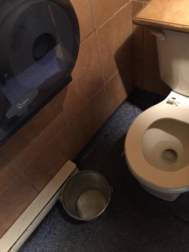 I go for a pee in one of the bars...is that beer bucket a barf bucket????