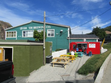 Back of Quidi Vidi Brewing Company and the small red building is a fish & chips canteen