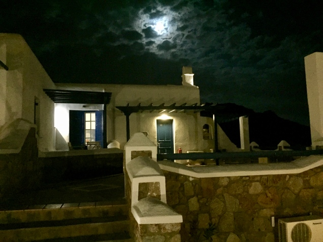 June, 2018 - Mykonos, Greece - Moon behind clouds