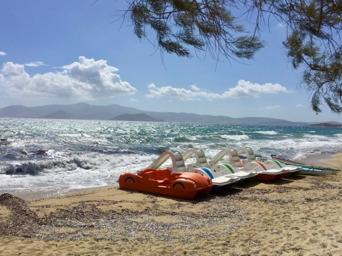June, 2018 - Agios Prokopios, Naxos, Greece - Windy day at the beach - Paddle boats