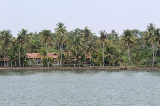 Nice home tucked away behind coconut trees