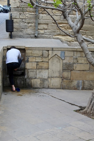 Old City, Baku - man washing for prayer