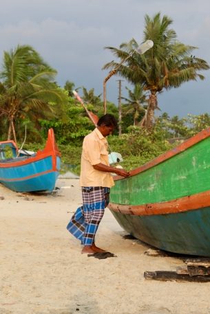 Fisherman working on his boat