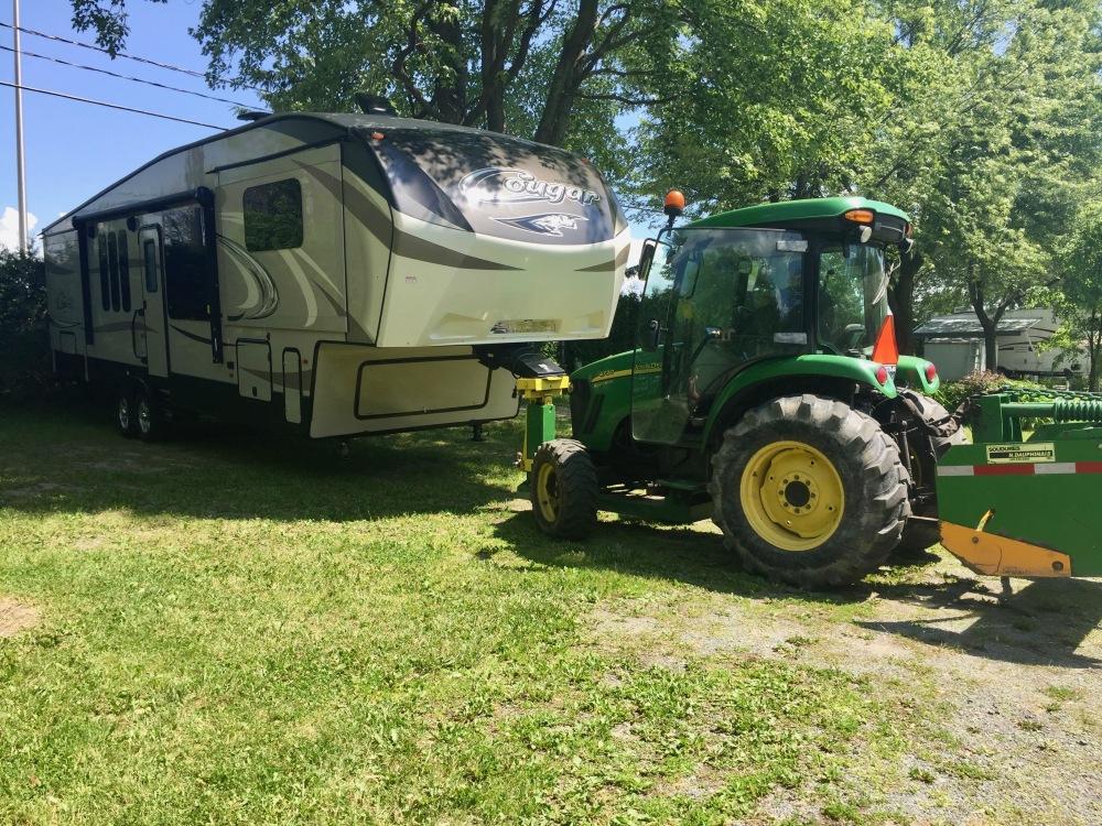 Sainte-Madeleine, Quebec - Camping Sainte-Madeleine - Cyril moving our 5th wheel into a nicer spot