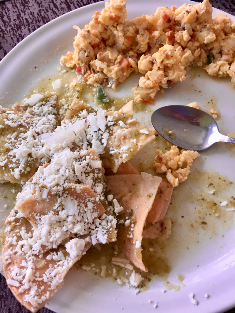 2019 - Chahué Bay - El Pibe de La Plata restaurant - Scrambled eggs with onions, tomatoes and chilies! They were SO spicy! With a side of Mexican chilaquiles! Spicy but tasty!