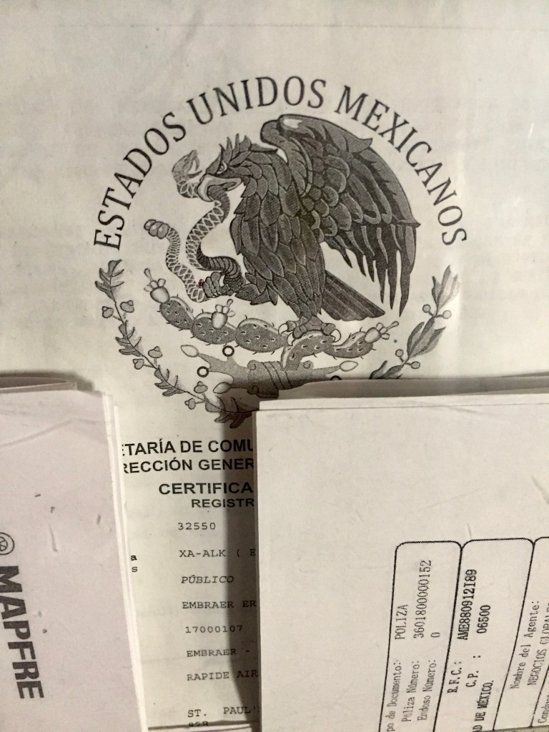 2019 - Air Mexico - Interesting paperwork on the wall across from the bathroom door.