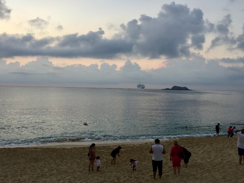 Chahué Beach, Chahué Bay, Huatulco, Mexico - Morning sunrise, a cruise ship approaches Santa Cruz Bay
