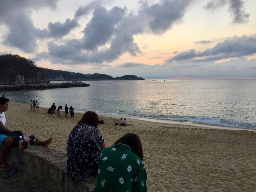 Chahué Beach, Chahué Bay, Huatulco, Mexico - Morning sunrise starts to color the sky pink...