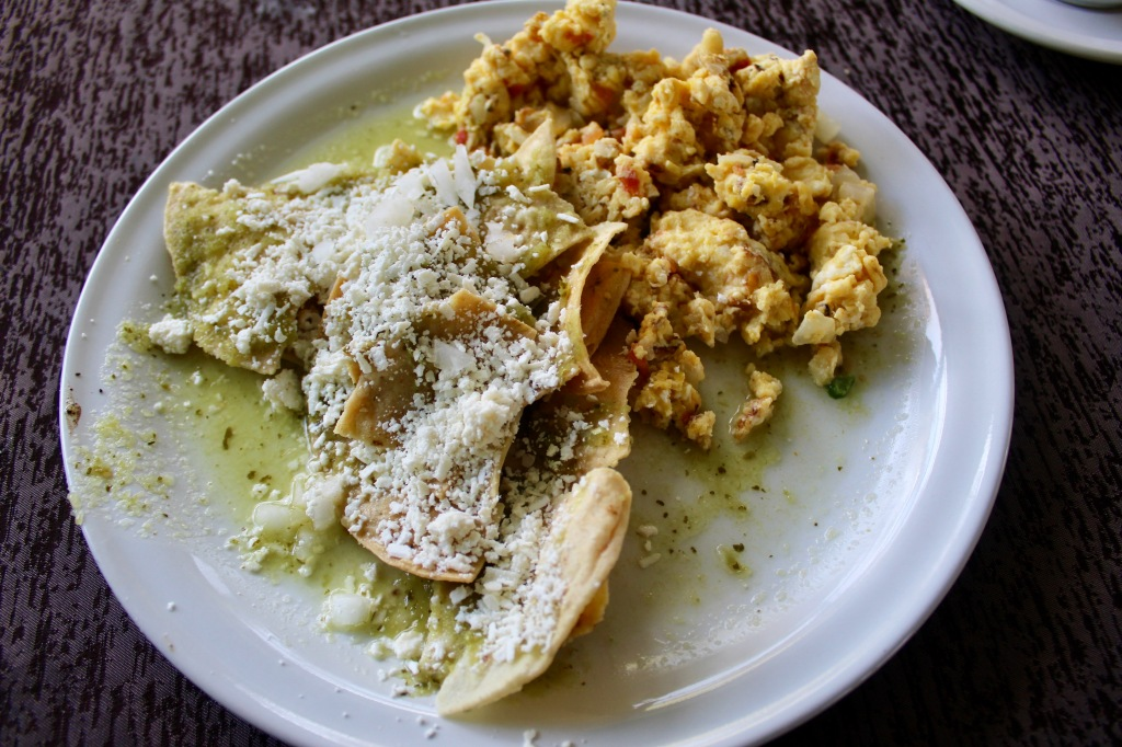 2019 - Chahué Bay - El Pibe de La Plata restaurant - Scrambled eggs with onions, tomatoes and chilies! They were SO spicy! With a side of Mexican chilaquiles!