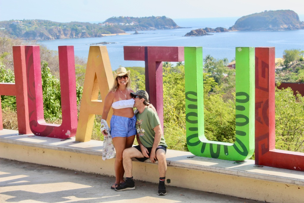 2019 - December - Tangolunda Bay, Huatulco, Mexico - Tourist spot overlooking Tangolunda Bay - Michael biting my boob!