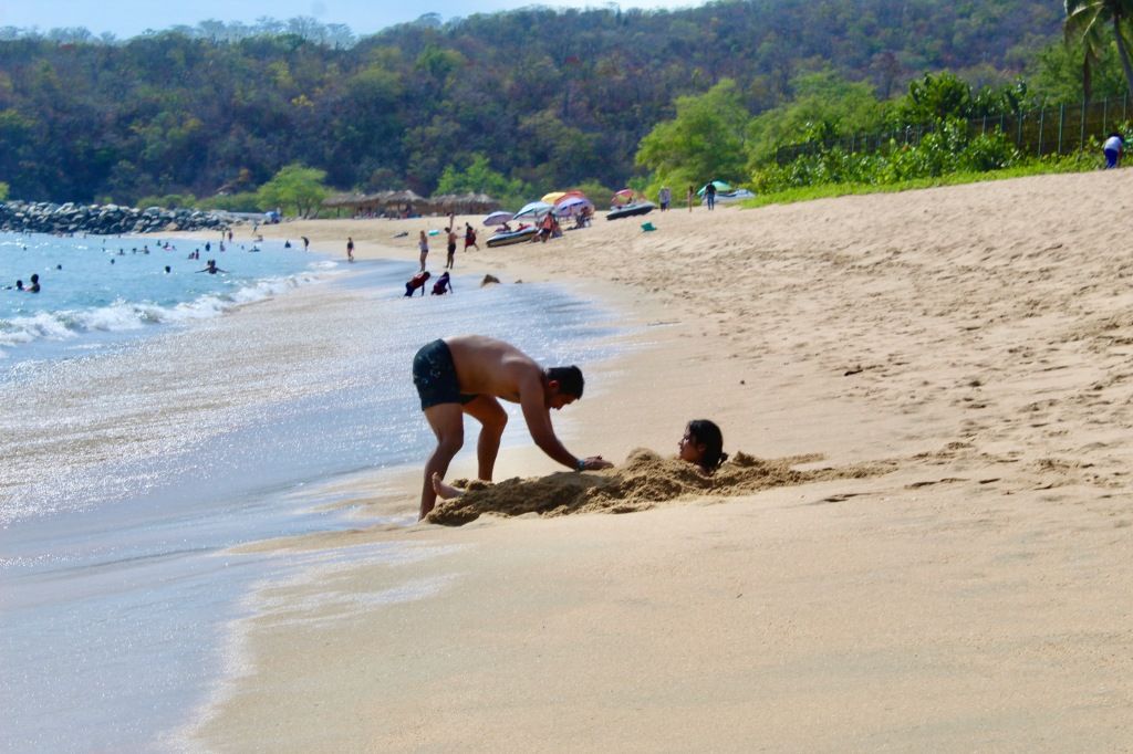 2019 - December - Tangolunda Beach, Huatulco, Mexico - Barcelo Huatulco - A man covering all parts of his partner in sand! ;)