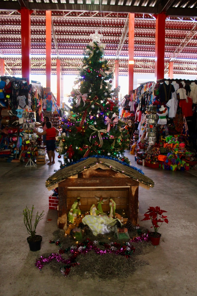 2019 - Huatulco, Mexico - New Year's Eve Day - Downtown La Crucecita - Indoor market lined with souvenir shops - Christmas tree and Nativity Scene