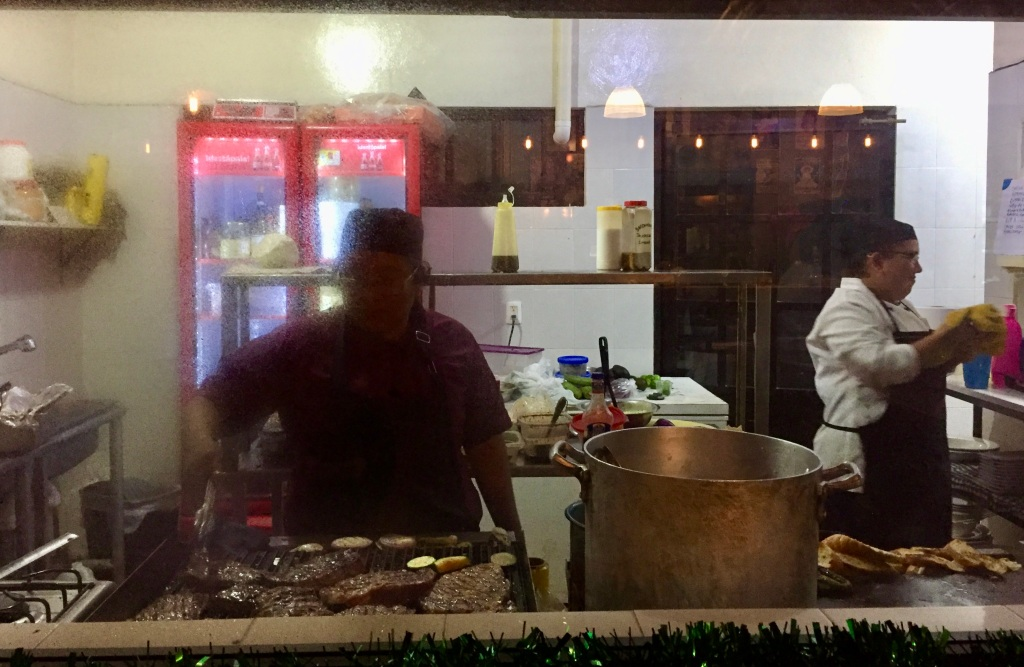 2019 - Huatulco, Mexico - New Year's Eve - Señor Barril Bar & Grill - Free snacks - Window to the kitchen - check out the steaks on the grill!!