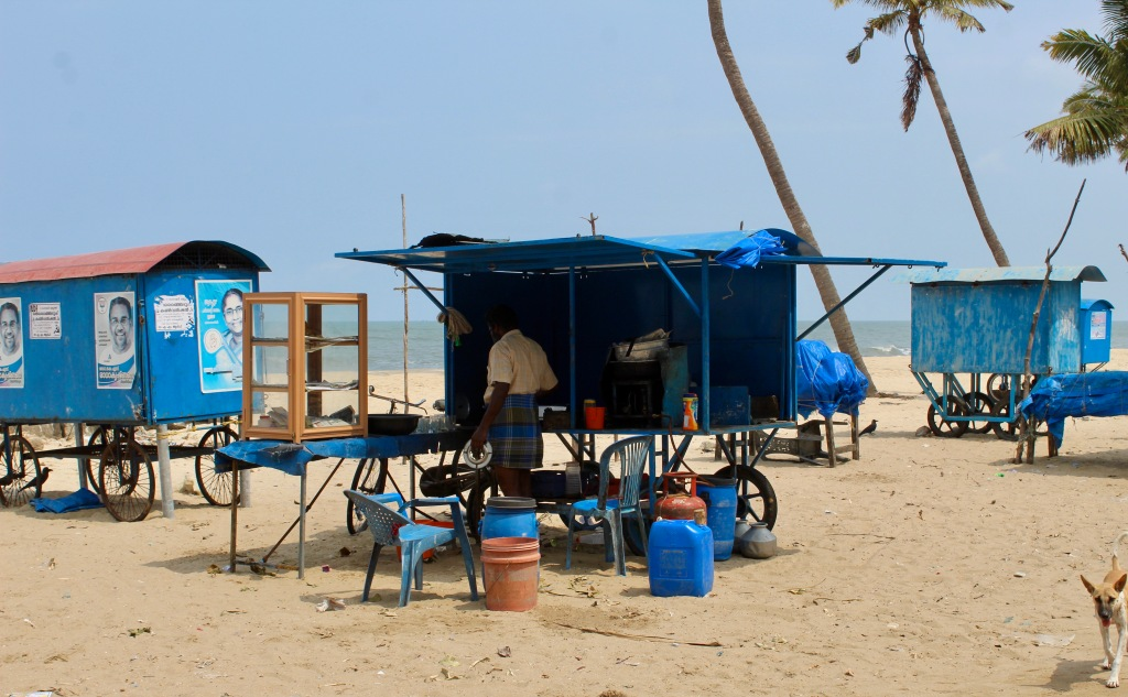 Mararikulam North, Kerala, India - Vendors selling tea and sweets at the beach