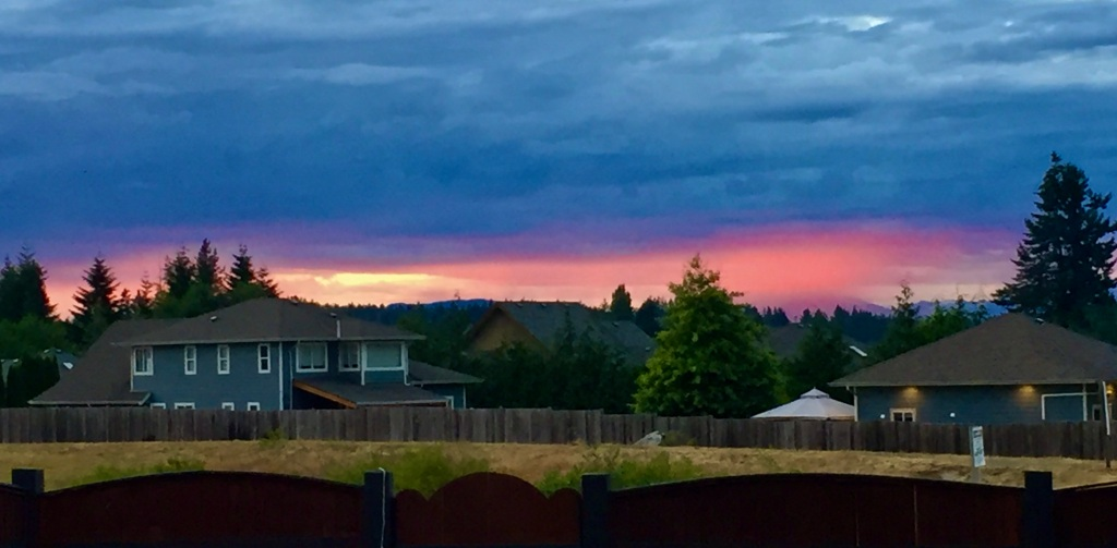 July, 2020 - Campbell River, Vancouver Island, British Columbia - Sunset that looks like a distant Coastal Mountain is a volcano is exploding