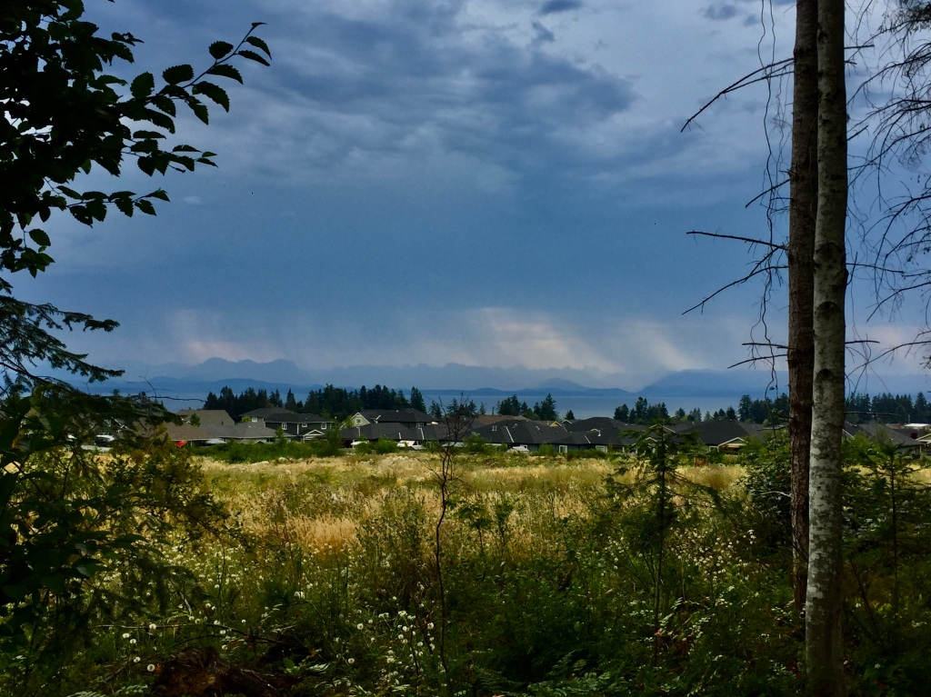 July, 2020 - Campbell River, Vancouver Island, British Columbia - Rainstorms sweeping across the mainland Coastal Mountains