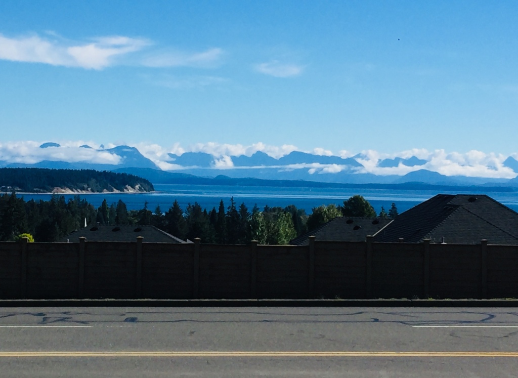 August/September, 2020 - Campbell River, Vancouver Island, British Columbia - Clouds on the mainland's Coastal Mountains