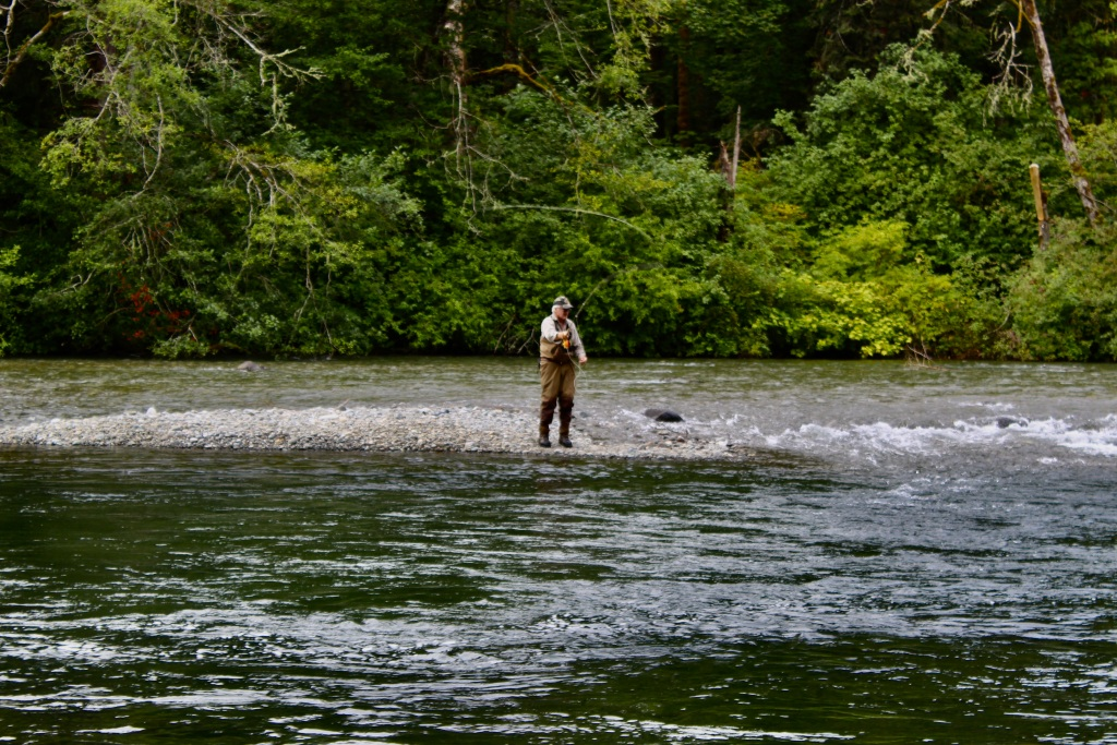 July, 2020 - Campbell River, Vancouver Island, British Columbia - Elk Falls Provincial Park - Salmon fisherman