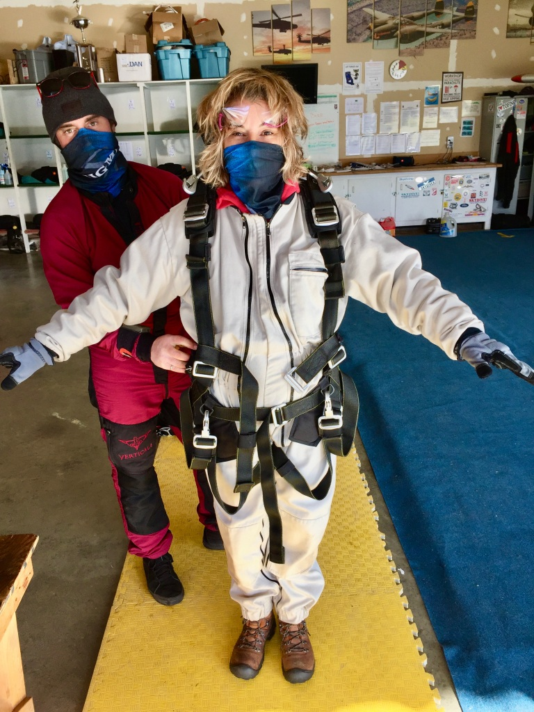 October 31st, 2020- Capital City Skydiving - Macko strapping the harness on me!