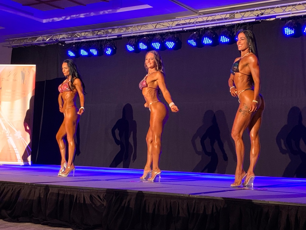 July 24th, 2021 - Moncton, New Brunswick - New Brunswick Natural CPA Championships - Patricia - in the middle - Patricia placed 1st and 3rd in the categories she competed in!